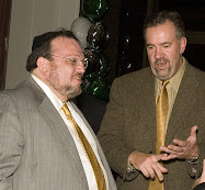 Joseph Shereshevsky, left, speaks to partner Steven Byers at an event in 2006.