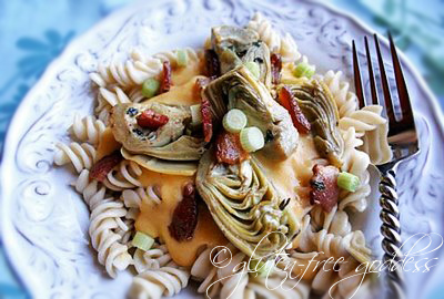 Gluten free pasta with bacon and artichoke hearts in a creamy sauce