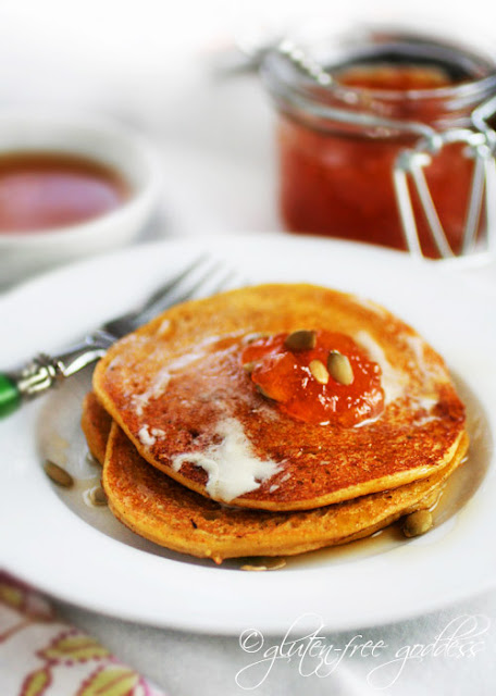 Delicious gluten-free pumpkin pancakes with maple syrup and apricot jam