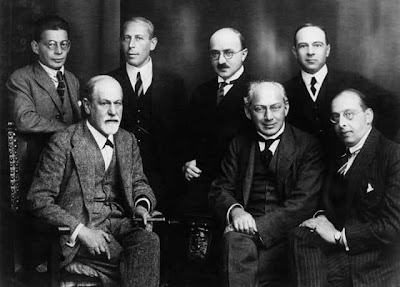 Vienna Psychoanalitic Society-The Committee-left to right seated: Freud, Sàndor Ferenczi, and Hanns Sachs (standing) Otto Rank, Karl Abraham, Max Eitingon, and Ernest Jones