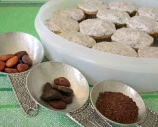 Cupcakes made with home-ground cocoa powder, left to right, the uppeeled beans, the peeled beans and the cocoa 'powder'