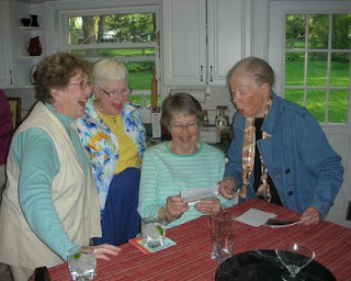 Four of the OCHERs, laughing over photos