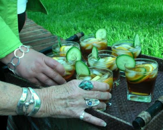 Mothers and daughters enjoying Pimm's on the patio, a refreshing summer cocktail, fresh and fruity