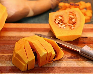 Cut the bulb into lengths (How to Safely Cut a Butternut Squash into Pretty Little Cubes, Step by Step ♥ AVeggieVenture.com)