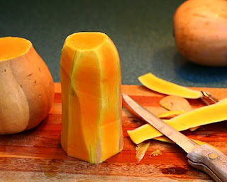 Slice the skin off the neck (How to Safely Cut a Butternut Squash into Pretty Little Cubes, Step by Step ♥ AVeggieVenture.com)