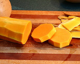 Cut the neck into rounds (How to Safely Cut a Butternut Squash into Pretty Little Cubes, Step by Step ♥ AVeggieVenture.com)