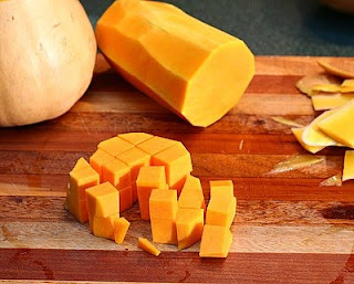Now cut the other way (How to Safely Cut a Butternut Squash into Pretty Little Cubes, Step by Step ♥ AVeggieVenture.com)
