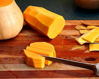 Cut through the rounds to form lengths (How to Safely Cut a Butternut Squash into Pretty Little Cubes, Step by Step ♥ AVeggieVenture.com)