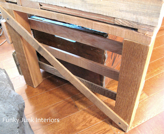 How to build a free rustic TV stand out of a pallet, with vintage crates for storage! Click to read full tutorial.