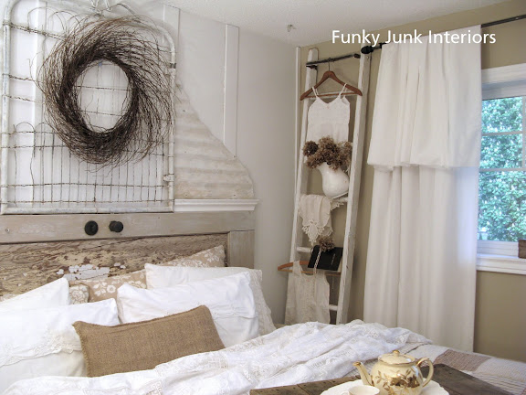 White Trash Bedroom reveal with old door and gate headboard, via FunkyJunkInteriors.net