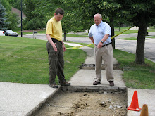 Tony Derezinski and Councilman Steve Rapundalo view sidewalk restoration