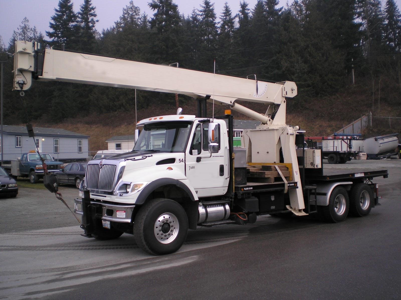 Runnion Equipment Company Custom Tractor Mount Boom Truck