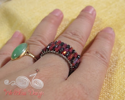 Wire wrapped seed beads adjustable ring on my finger