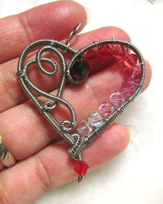 Holding the stainless steel wire woven heart with Swarovski Crystal