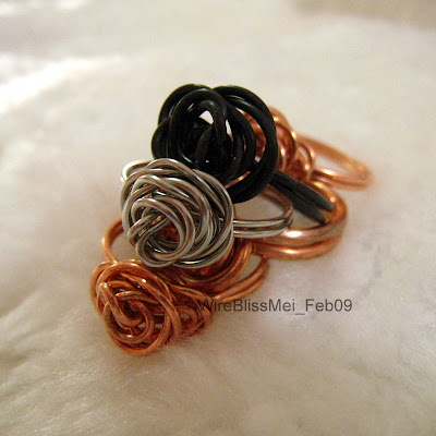 Wire wrapped black steel, stainless steel and copper wire rose rings