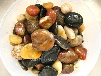 Collection of colorful river rocks