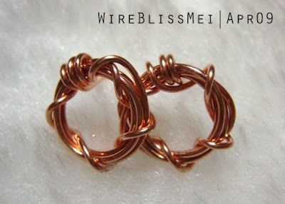 Sparkly 'O' Studs wire wrapped earrings with copper wire