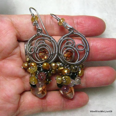 Holding the Wire Wrapped/Coiled Earrings - Fruity