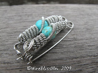 two identical wire wrapped brooch