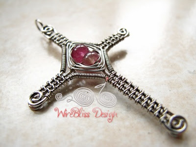 Close up of Wire Woven Cross Pendant with Tourmaline