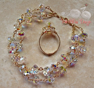 holding a double strand wire wrapped bracelet and ring - swarovski crystals and gold filled wire