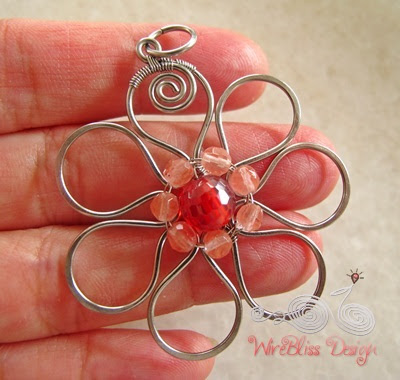 wire wrapped flora pendant with gemstones on my palm