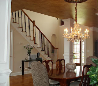 Formal Dining Room with crystal chandelier, wainscotting, and aritst faux paint ceiling