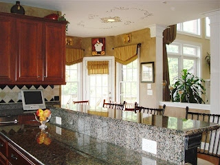 Kitchen includes granite countertops, work desk and center island. Includes view to breakfast nook