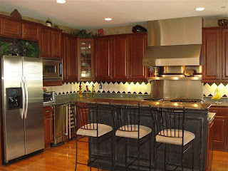 Gourmet Chef's Kitchen with commercial grade Viking appliances (dual ovens, refrigerator, 6 burner gas cooktop, dishwasher), custom cabinets with under cabinet lighting and custom tile backsplash