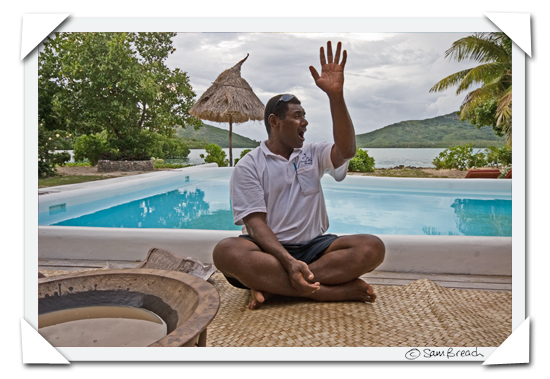 picture photograph image Seruvi illustrates the correct sitting position traditional Fijian Kava for a Kava ceremony ay Navutu Stars resort on the island of Yaqeta in the Yasawas 2008 copyright of sam breach http://becksposhnosh.blogspot.com/