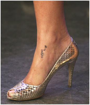 collection of body art then look no further then Rihanna's tattoos.