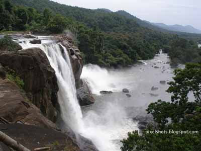 athirapally water falls,kerala tour spots,athirapally thrissur,kerala tourist destinations,waterfalls in kerala,athirapilly aerial view