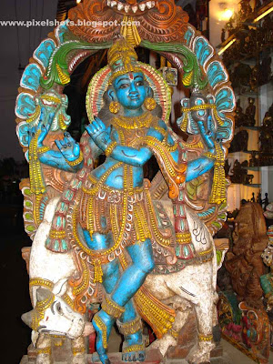 hindu god krishna beautiful statue in a shop in mahabalipuram