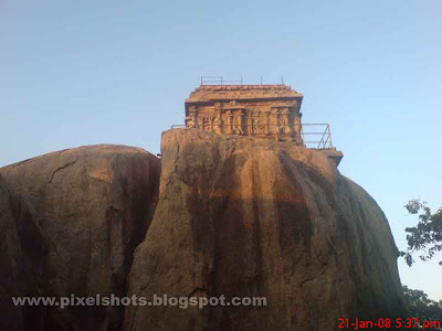 hindu temple over the top of rocks in mahabalipuram the open air museum