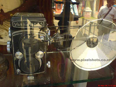 photograph of oldest film cameras of japan camera brand yashika for sale in an antiques shop in mattancherry jew street in cochin india kerala