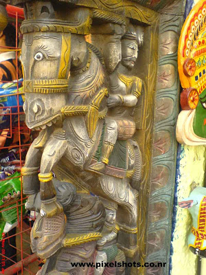 sculpture made in timber for sale in an antiques shop in jew street of cochin kerala india