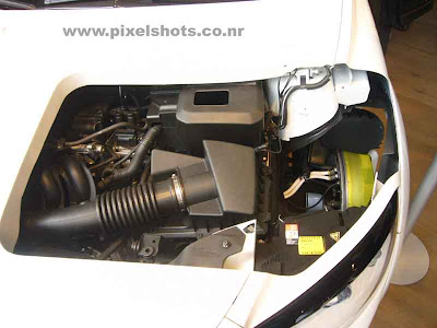 volvos electric car engine closeup photograph also the electric dynamo for the car inside the car wheel is seen in the photograph