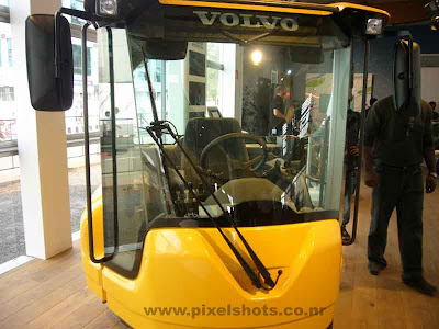 volvos yellow cab known as safety cab demonstrated in automobile show in cochin kerala, weired vehicle, cute cab from volvo, american car makers, vehicles displayed in volvo autoshow