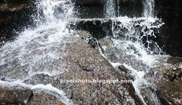 splashing mountain stream,small milky water cascade en route thenmala,road side waterfalls in kerala,fresh bubbling waterfalls closeups,stream falling down and splashing on rocks,mountain tears