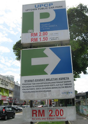Signboard pointing to UPCP Open Car Park entrance