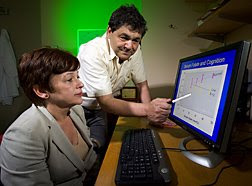 Epidemiologist Martha Morris and biochemist Jacob Selhub examine graphical evidence of the interaction between vitamin B12 status and folate status in relation to cognitive test results. Photo courtesy of the USDA, ARS