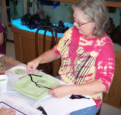 Denise works with a tree stencil.