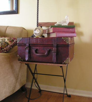 A quick and easy side table with a vintage chair and suitcase