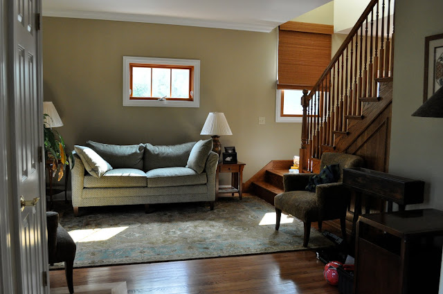 Living room before. Make the space look more open by mmoving the furniture placement.
