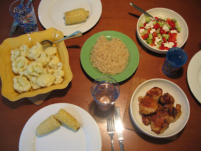 Chicken thighs, Israeli couscous, steamed cauliflower, and salad with feta