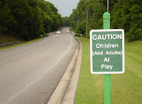 Life at Spruce Creek: CAUTION Children and Adults at Play