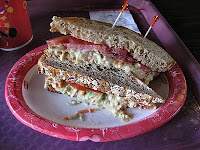 The Lighthouse Sandwich Columbia Harbour House The Recipes Of Disney Ingredients:Olive Panini Bread¼ cup Hummus (recipe follows)½ cup Broccoli slaw (recipe follows)Vine ripe tomatoes sliced (2 slices per sandwich)