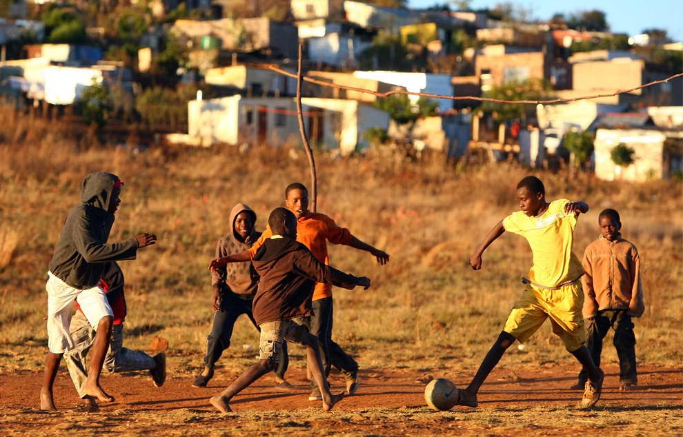 Image result for children in the streets in africa playing football