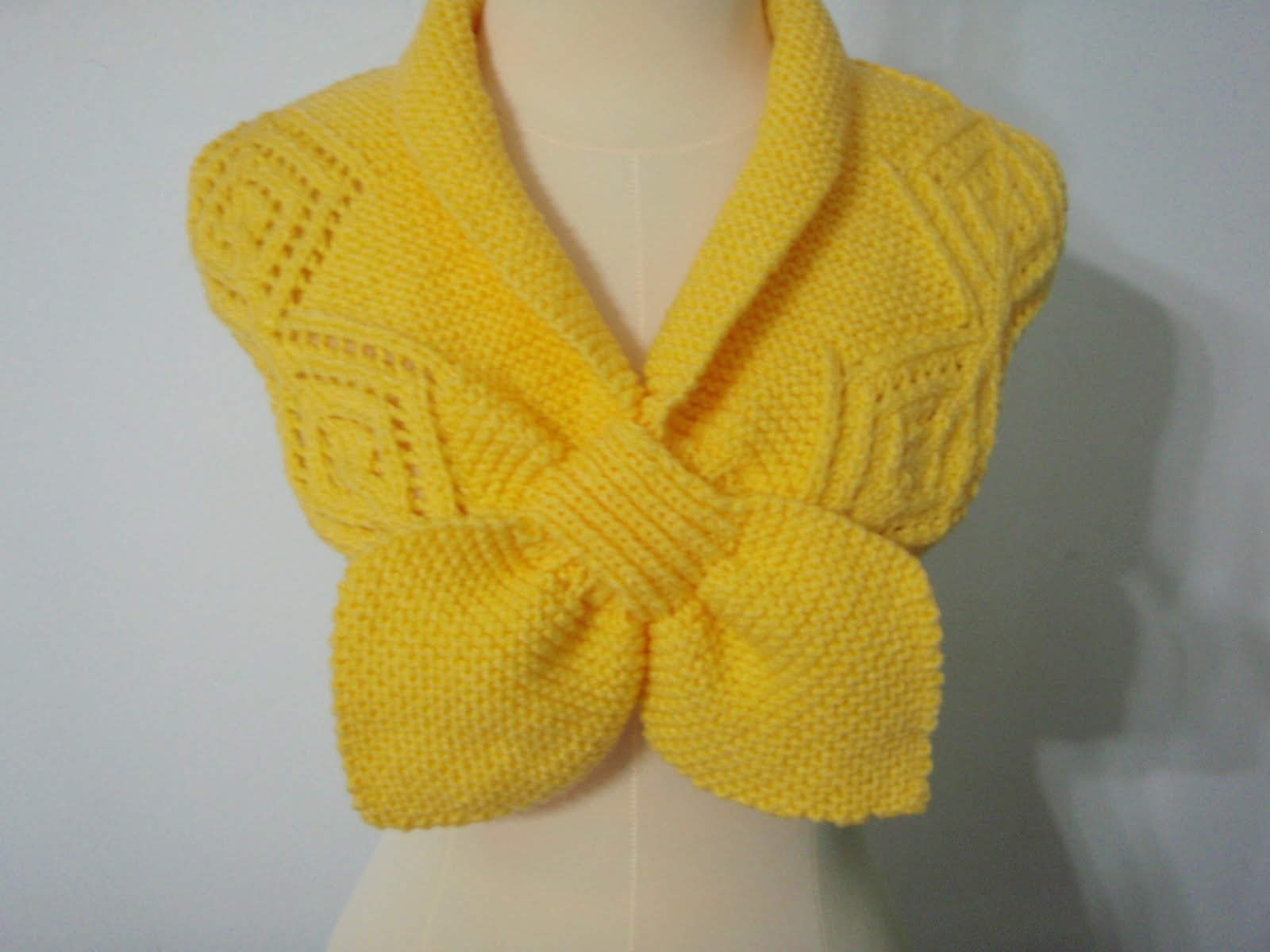 this is hand knitted neck warmer in shade of light yellow this style ...