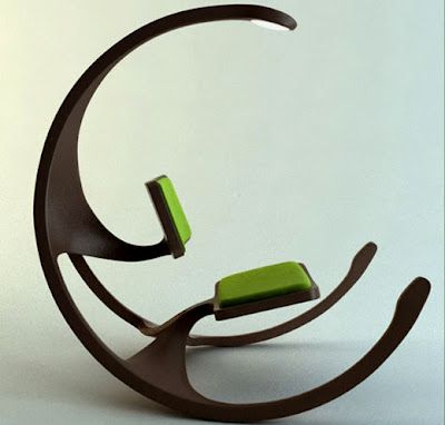 With Spindly Dinosaur Legs And An Ever Important Overhead Light, The  Rocking Chair Manages To Be Simultaneously Hip And Terrifyingly Ugly. Itu0027s  A Is Really ...